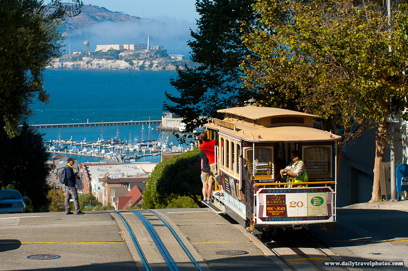Cable Car Descends Hyde Street with Alcatraz in Background - San Francisco, California, USA - Daily Travel Photos
