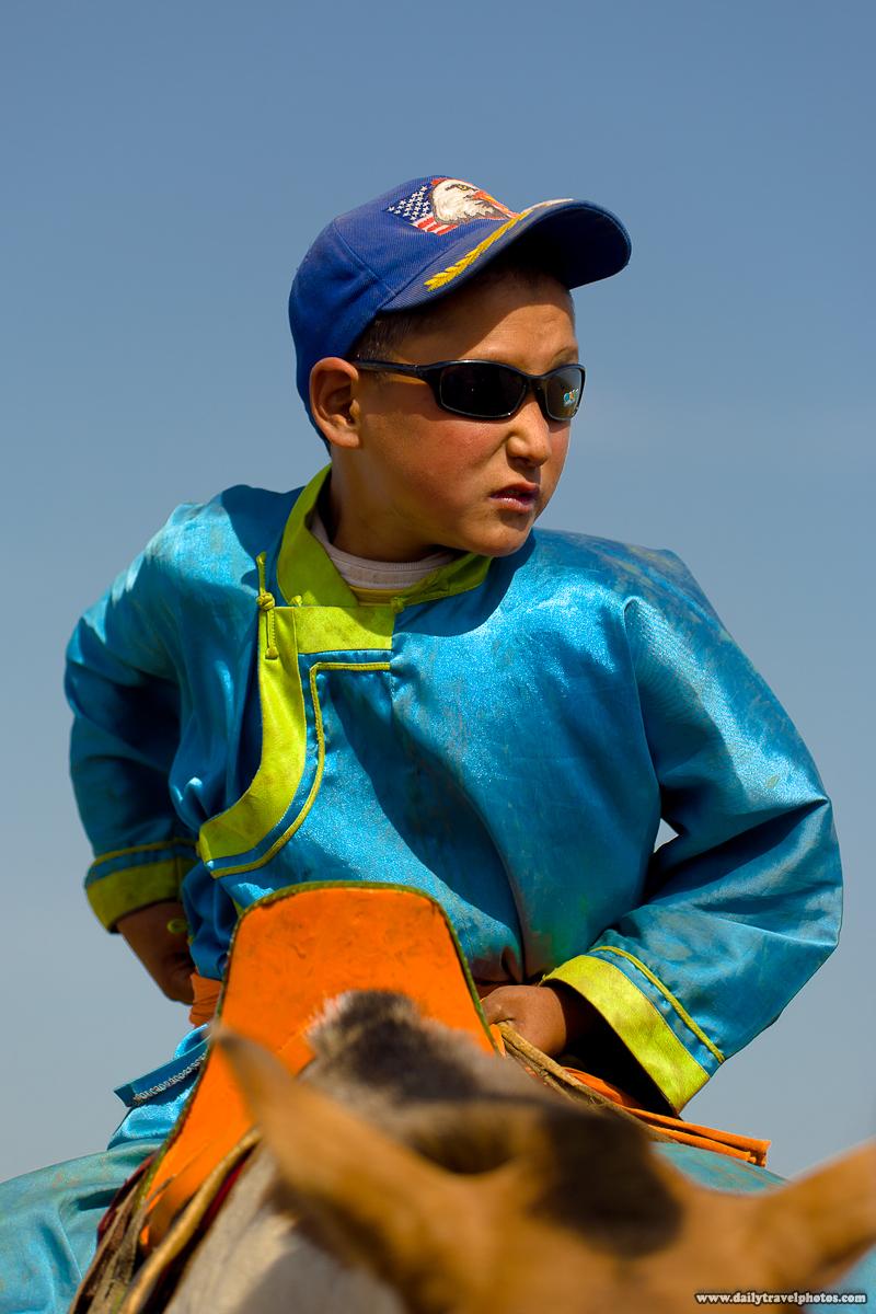 Young Mongolian Cowboy on Horseback with Traditional Blue Del - Ulaan Baatar, Mongolia - Daily Travel Photos