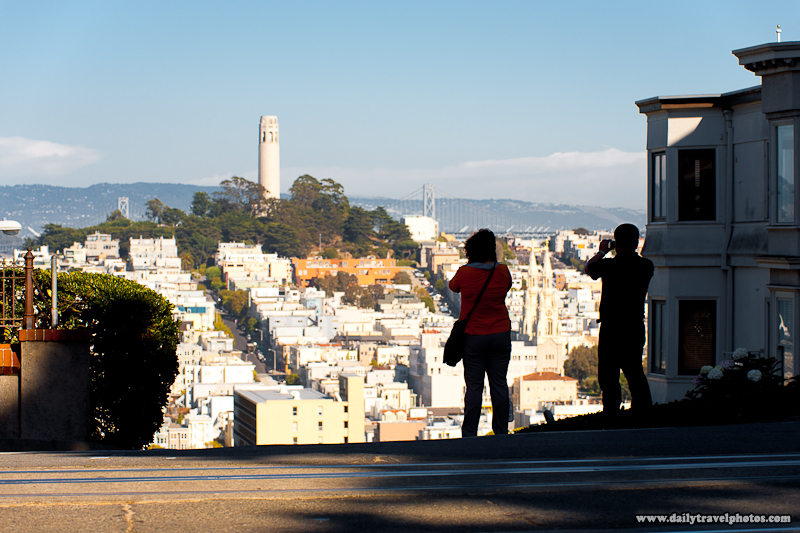 Tourists Photographing Coit Tower Urban Landscape from Top of Lombard Street - San Francisco, California, USA - Daily Travel Photos