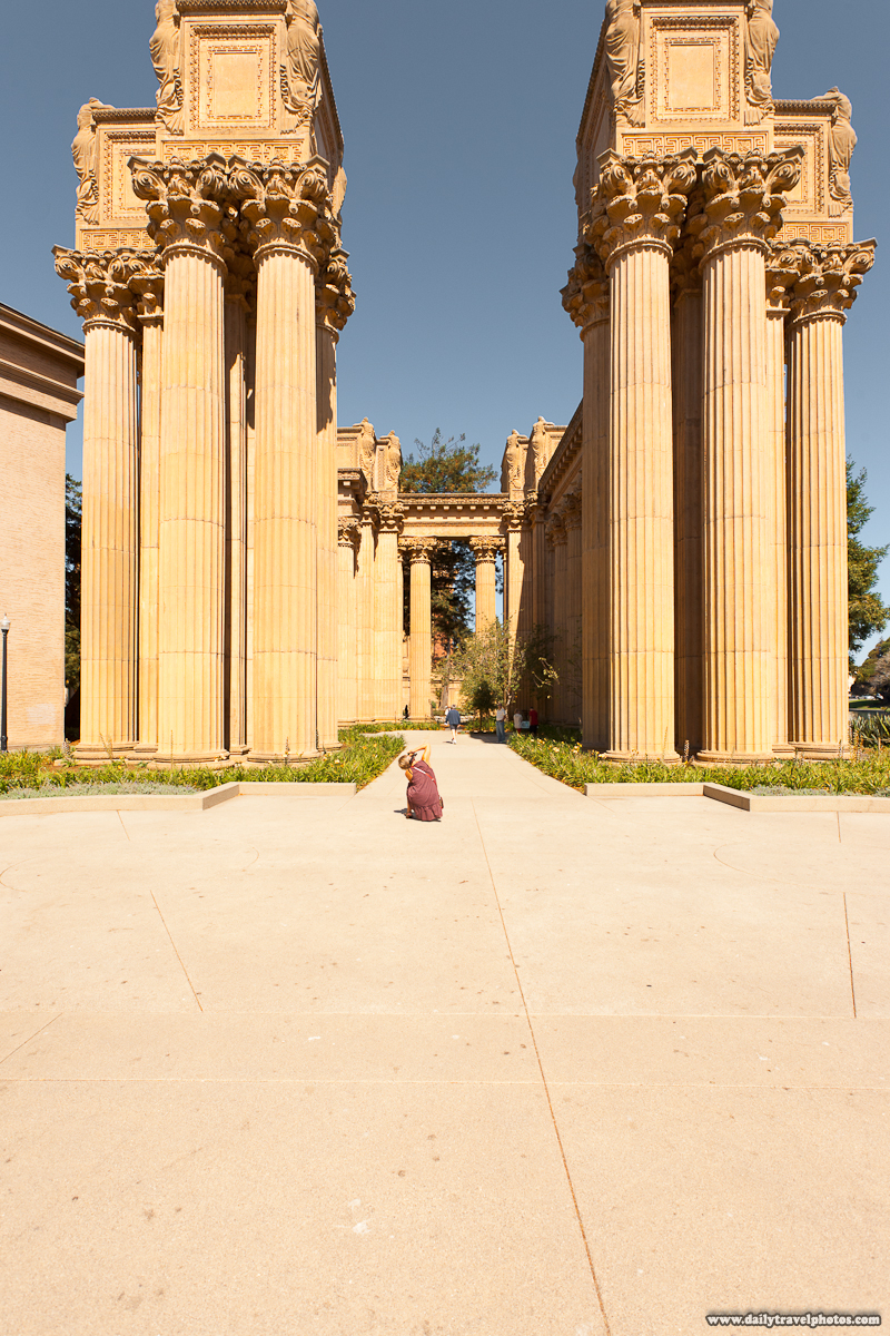 Photographer Crouching at Columns of Palace of Fine Arts - San Francisco, California, USA - Daily Travel Photos
