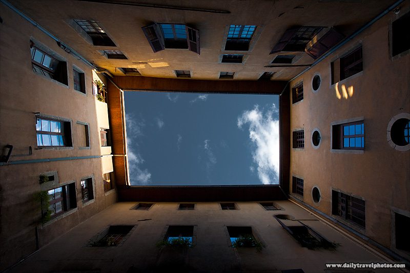Viewing Directly up of Closed Courtyard in European Apartment Complex - Chambery, France - Daily Travel Photos