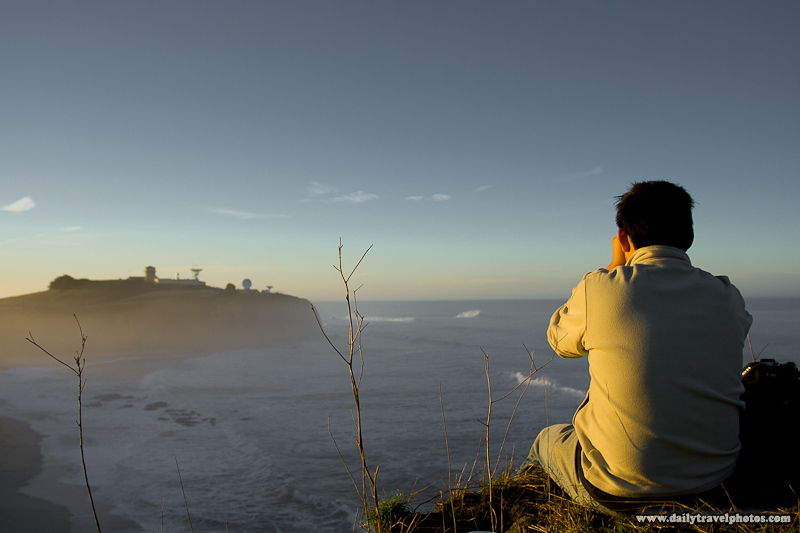 Spectator on Cliff Watching Maverick's Surfing at Dawn - Half Moon Bay, California, USA - Daily Travel Photos