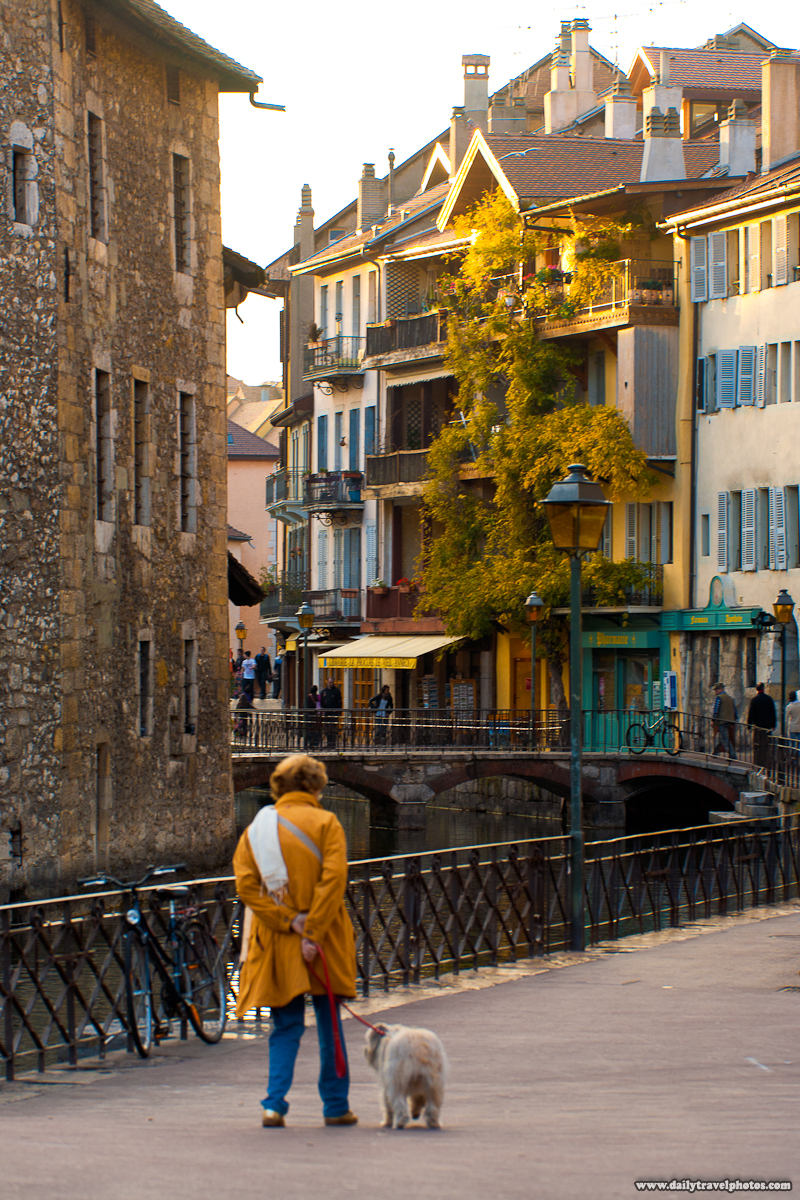 Woman Walking Dog Near Palais de l'isle - Annecy, Haute-Savoie, France - Daily Travel Photos