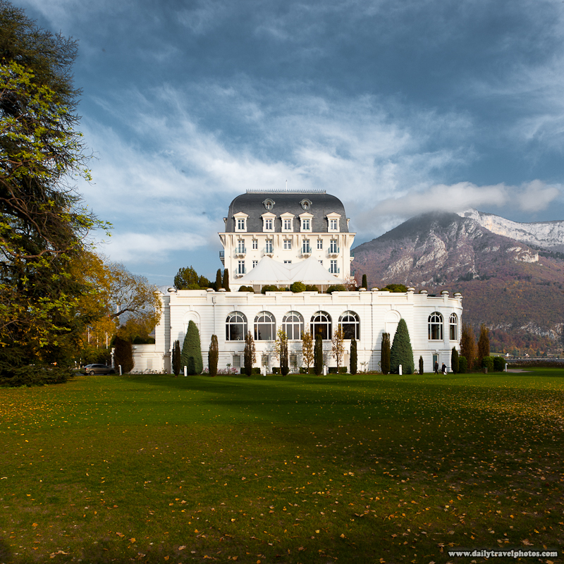 Side View of Hotel Imperial Palace Lakeside Casino and Background Mounatins - Annecy, Haute-Savoie, France - Daily Travel Photos