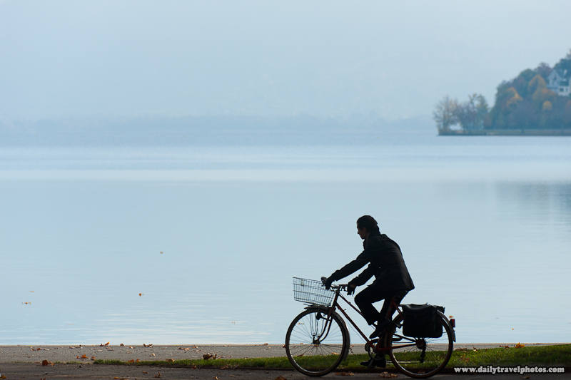 Bicyclist Rides Along Path of Annecy Lake - Annecy, Haute-Savoie, France - Daily Travel Photos