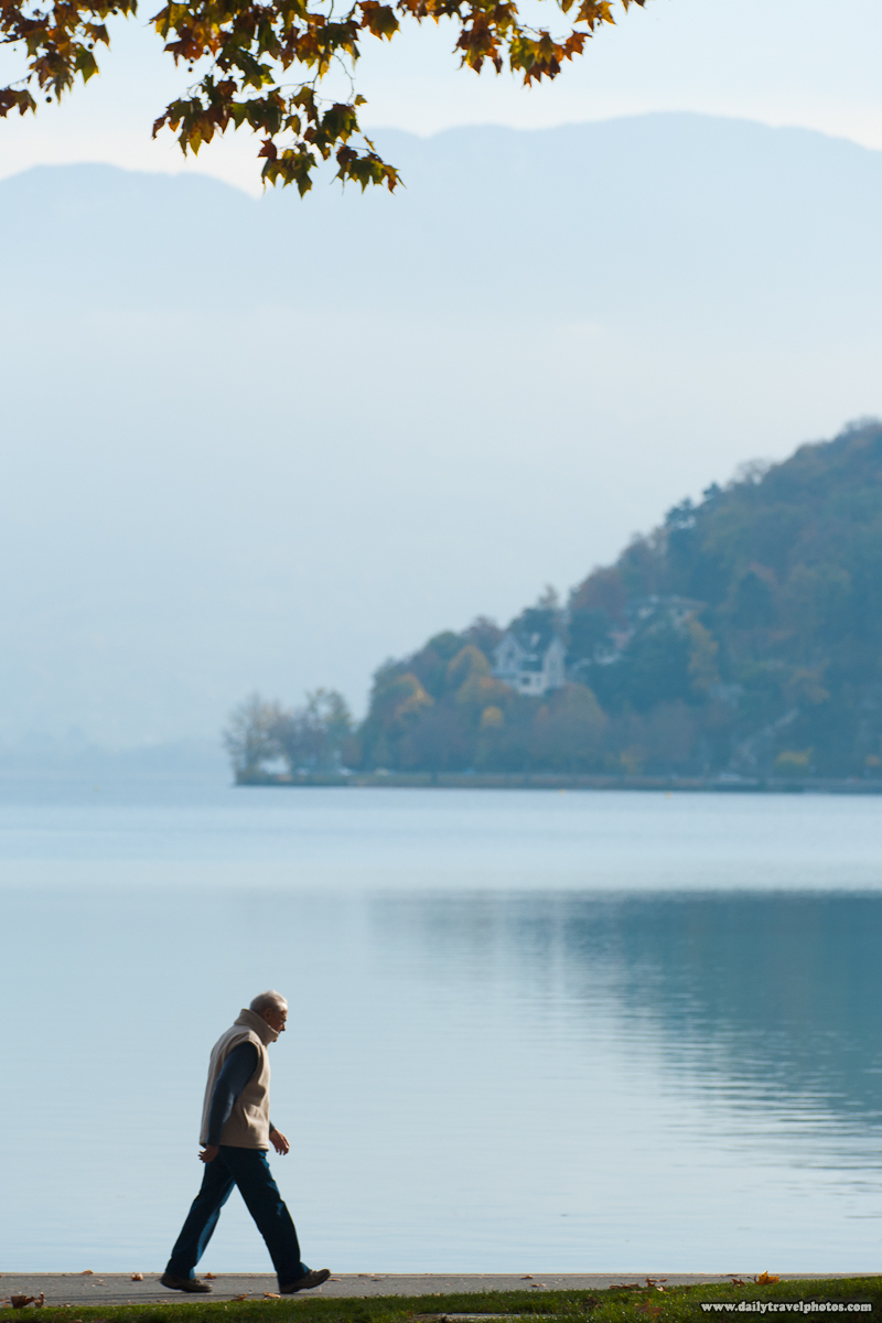 Local Resident Walking Along Annecy Lake in Autumn - Annecy, Haute-Savoie, France - Daily Travel Photos