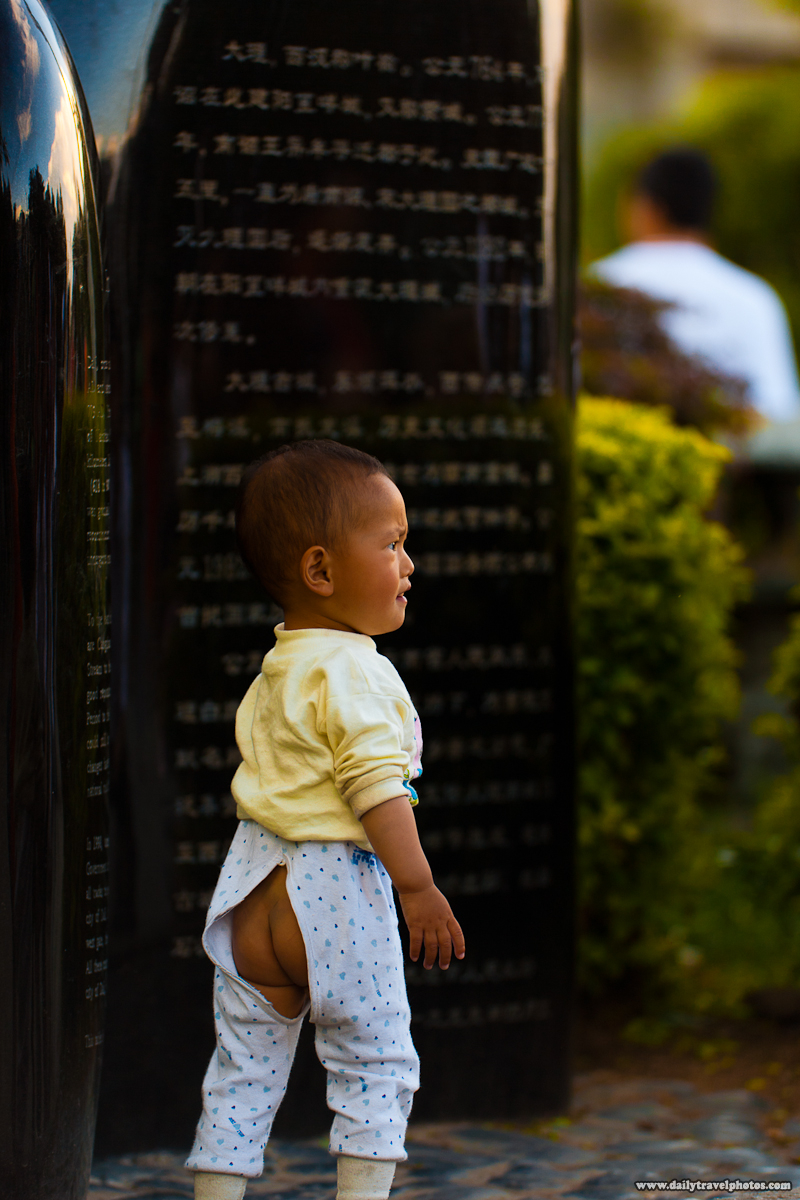 Young Chinese Toddler in Butt Exposing Pants Easy for Toilet - Dali, Yunnan, China - Daily Travel Photos