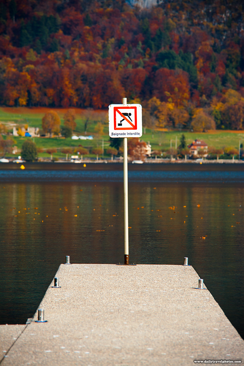 No Swimming Sign at End of Pier in Annecy Lake - Annecy, Haute-Savoie, France - Daily Travel Photos