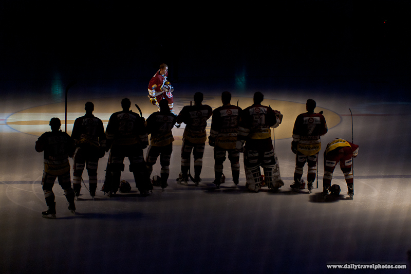 Geneva-Servette Professional Ice Hockey Player Joins Waiting Teammates during Introductions - Geneva, Switzerland - Daily Travel Photos