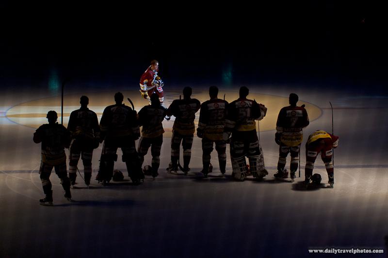 Geneva-Servette Professional Ice Hockey Player Joins Waiting Teammates during Introductions - Geneva, Switzerland - Daily Travel Photos