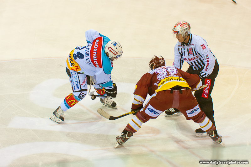 Swiss Ice Hockey Game Faceoff Action - Geneva, Switzerland - Daily Travel Photos