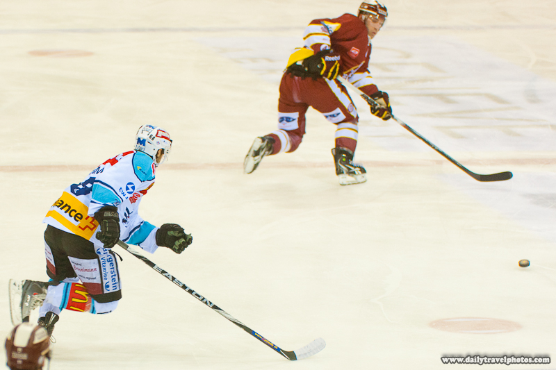 Swiss Professional League Ice Hockey Game Player Receives Pass Up Ice - Geneva, Switzerland - Daily Travel Photos