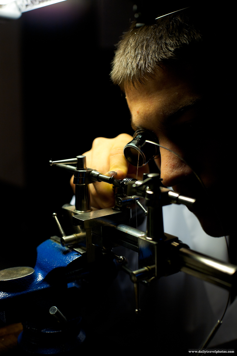 Swiss Watchmaker's Lathe Instrument Grinding Down Hand Made Watch Part - Geneva, Switzerland - Daily Travel Photos
