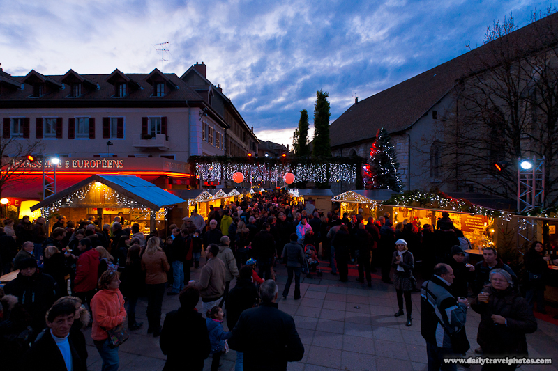 Crowded Christmas Market Teaming with Tourists at Dusk - Annecy, Haute-Savoie, France - Daily Travel Photos