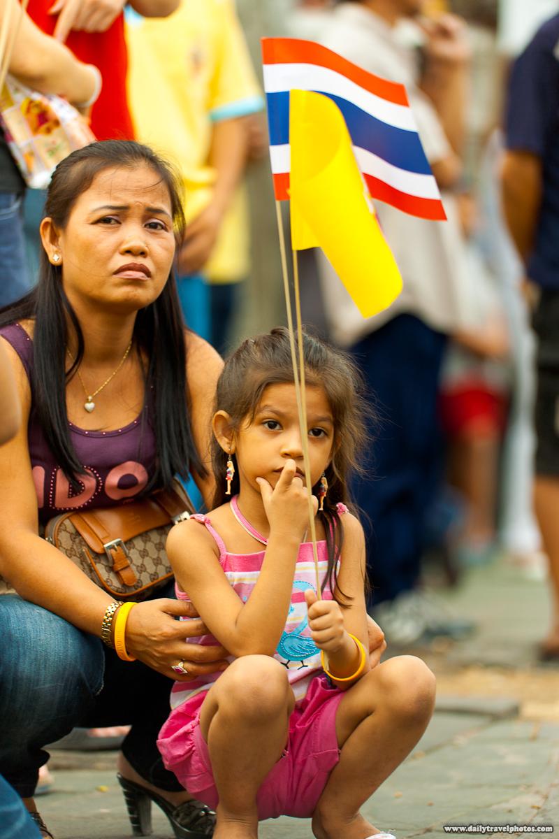 Thai Mother n Daughter Wave Flags While Awaiting the King - Bangkok, Thailand - Daily Travel Photos