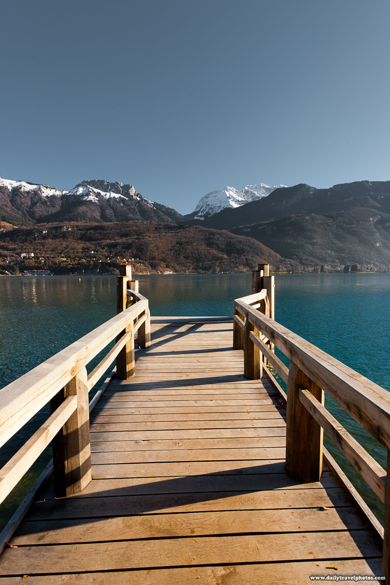 Pier on Annecy Lake with Snowcapped French Alps Mountains - Annecy, Haute-Savoie, France - Daily Travel Photos