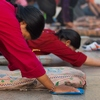 photo: Tibetan Pilgrim Prostration - A Tibetan woman in mid-prostration at the Jokhang temple in Lhasa (ARCHIVED PHOTO on the weekends - originally photographed 2007/10/17).