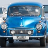 Morris Minor Classic Photo: A classic Morris Minor car comes cruising over the Phra Pinklao bridge in Bangkok.