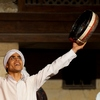 Egyptian Whirling Dervish Photo: A Sufi dancer ends a routine with gusto at the Al-Ghouri complex in Cairo (ARCHIVED PHOTO on the weekends - originally photographed 2010/07/03).