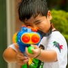 Songkran Shooting Photo: A young Thai boy takes aim at a defenseless, unarmed photographer during Songkran.
