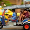 photo: Songkran Tuk-Tuk Attacks - Thai tuk-tuk passengers cower in terror from a barrage of water-gun attacks during Songkran.