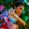 Songkran Tiny Dancer Photo: A cute Thai girl performs a native dance in colorful garb for Songkran, Thai new year.
