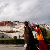 Potala Palace Plebeians Photo: Two Tibetan women in traditional dress cross the front of the Potala Palace in Lhasa (ARCHIVED PHOTO on the weekends - originally photographed 2007/10/17).