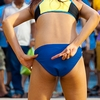 Fanny Finger Photo: A teammate's hidden signal indicates which player to target at a women's beach volleyball exhibition at Central World Mall.
