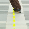 Intricate Inliners Photo: An inline skater slaloms a course of small, evenly-spaced pylons at Central World Mall in Bangkok.