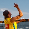 Big Ups Photo: A men's beach volleyball player jumps sky-high for a spike during a tournament sponsored by Coop in Geneva.