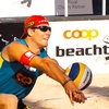 photo: Dashing Digger - A handsome men's beach volleyball player digs a spiked ball in at a Coop sponsored volleyball tournament in Geneva.