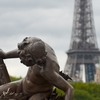 Iron Locks Photo: A statue on the Alexandre III Bridge with the Eiffel Tower in the background.