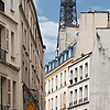 Iconic Iron Photo: The Eiffel Tower sprouts over residential buildings in Paris.
