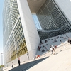 Grande Arche Photo: Tourists and locals relax at the base of the Grande Arche de La Defense in Paris.