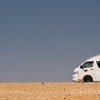 Desert Drive Photo: A tourist van motors along at the Giza pyramids desert in Egypt (ARCHIVED PHOTO on the weekends - originally photographed 2010/10/26).