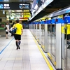 Spotless Subway Photo: A passenger walks on an immaculate subway platform on the metro system in Taipei.