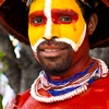 Taipei Tribesman Photo: A Papua New Guinea man displays the traditional tribal clothes of his countrymen.