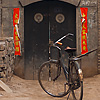 Asian Alley Photo: An old bicycle is left parked at the end of a traditional Chinese alleyway in Pingyao, China (ARCHIVED PHOTO on the weekends - originally photographed 2007/07/04).