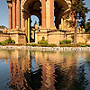 photo: Salmon Centerpiece - A pond reflects the salmon-colored central dome structure at the Palace of Fine Arts in San Francisco.