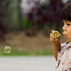 Bubble Boy Photo: A young Indonesian child is busy blowing bubbles at a local park in Bukittinggi, Sumatra (ARCHIVED PHOTO on the weekends - originally photographed 2007/02/05).