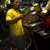 Nut Nut Photo: A chestnut vendor cooks up a batch at the night market Kuala Lumpur's Chinatown (ARCHIVED PHOTO on the weekends - originally photographed 2006/09/29).