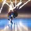 "Ice Intro's Photo: A Geneva-Servette, ""Wild Eagle"" skates onto the ice during pyrotechnic-enhanced introductions."