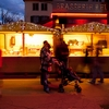 Chalets Shopping Photo: Tourists enjoy a chalet cheese shop at a Christmas market in old Annecy at dusk.